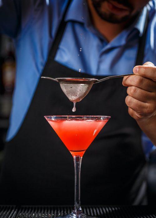 barman-makes-cosmopolitan-cocktail.jpg